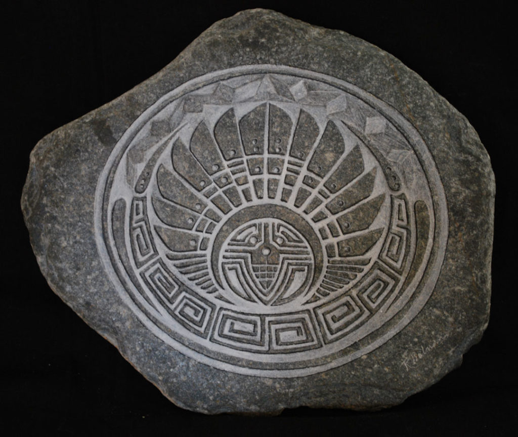 Crop Circle etched in stone with white acrylic highlights.